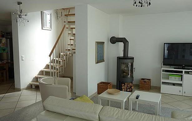 03 Wohnzimmer mit Ofen